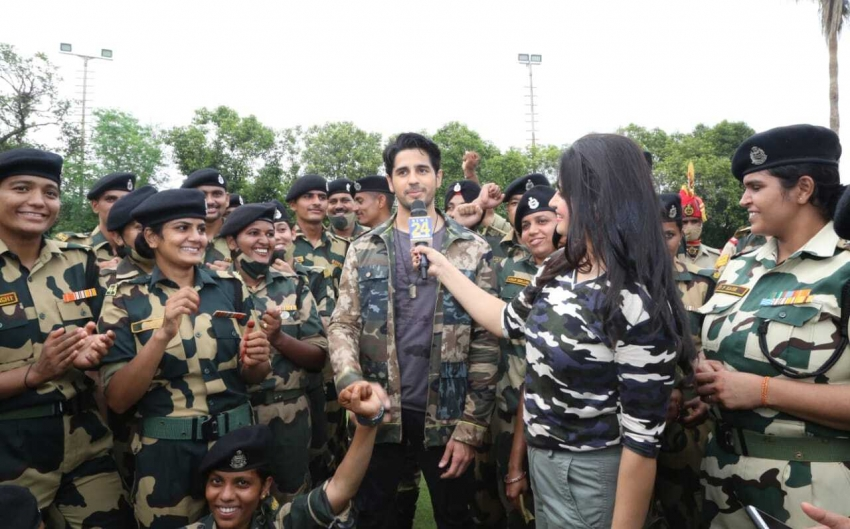 Siddharth Malhotra and Kiara Advani with BSF soldiers during promotion of upcoming film Shershaah Photos